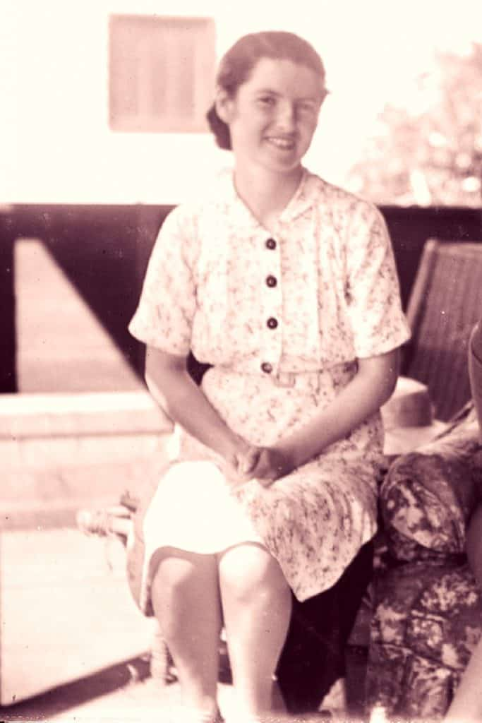 Seated young woman in summer dress with collar